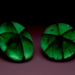 Photograph of two trapiche emeralds (G9122 and G9135)