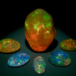 Photograph of six Mexican fire opals (G3968, G3886, G2111, G3964, G1072, and G2028) from the National Gem Collection